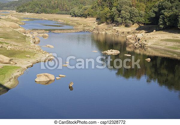 Boulders in a river - csp12328772