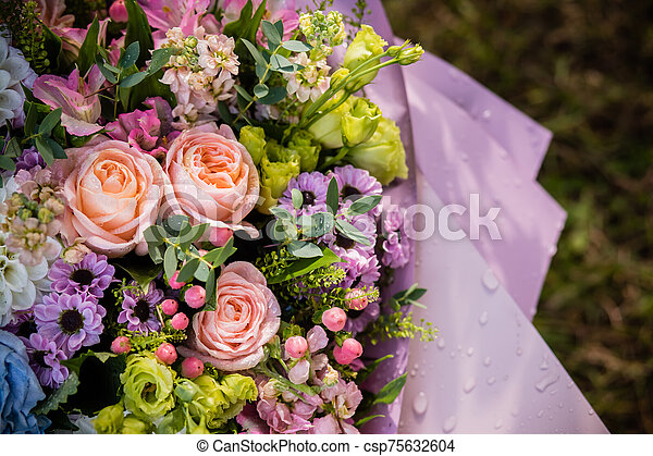 bouquet made of Alstroemeria, Gerber, Rose and Chrysanthemum flowers isolated on green. Composition of roses and chrysanthemums. Celebration, floral present. Copy space - csp75632604