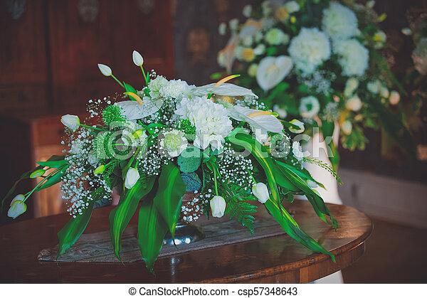 bouquet of beautiful flowers in vase - csp57348643