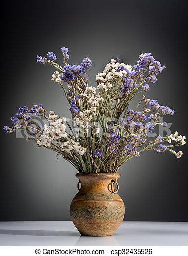 Bouquet of flowers in old vase - csp32435526