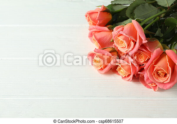 Bouquet of fresh pink roses on wooden background, closeup - csp68615507