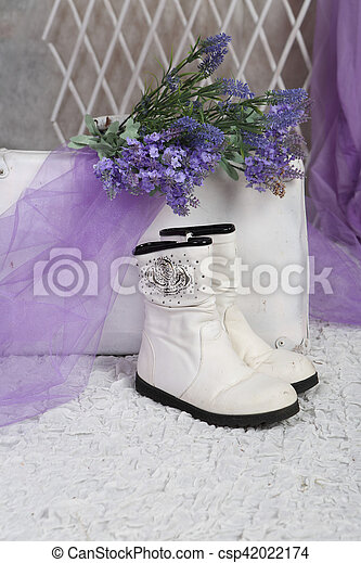 bouquet of lavender rests on an old suitcase in a bright room - csp42022174