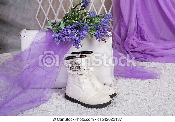 bouquet of lavender rests on an old suitcase in a bright room - csp42022137
