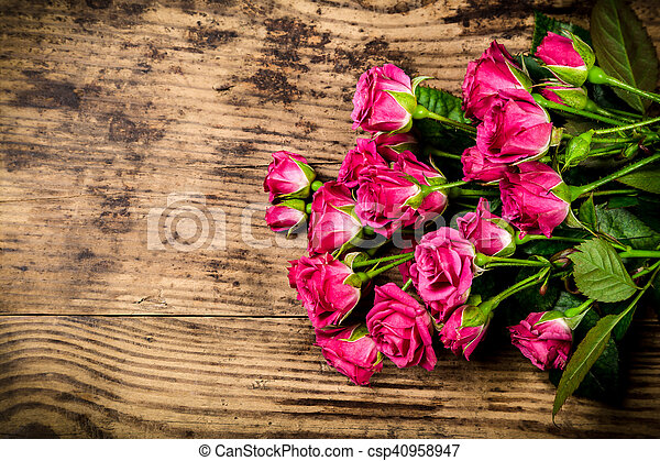 Bouquet of little pink roses on wooden background - csp40958947
