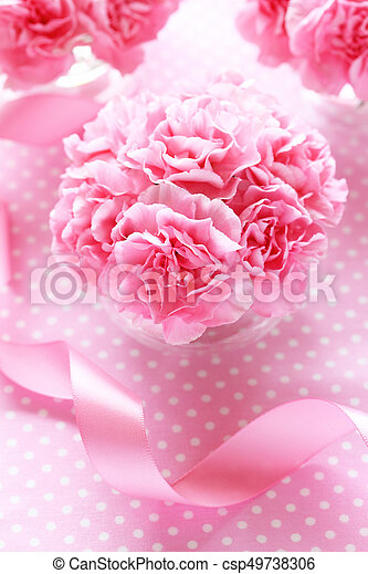 Bouquet of pink carnation flowers with pink ribbon on pink bouquet of pink carnation flowers with pink ribbon on pink backgroundtop view csp49738306 mightylinksfo
