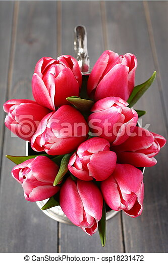 Bouquet of pink tulips in metal vase on wooden background - csp18231472