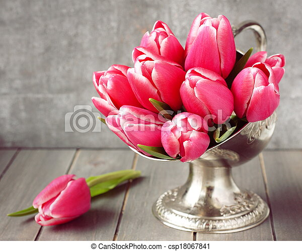 Bouquet of pink tulips in metal vase on wooden background - csp18067841