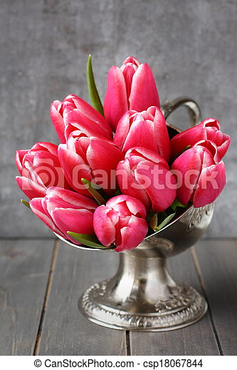 Bouquet of pink tulips in metal vase on wooden background - csp18067844