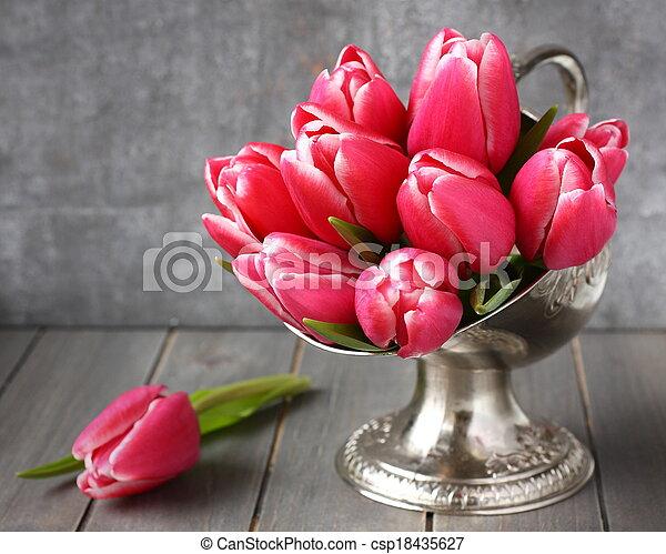 Bouquet of pink tulips in metal vase on wooden background - csp18435627