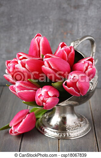 Bouquet of pink tulips in metal vase on wooden background - csp18067839