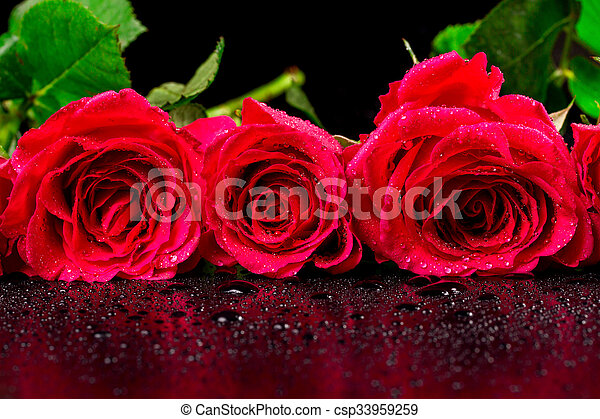 Bouquet Of Red Roses With Dew Drops On A Black Background