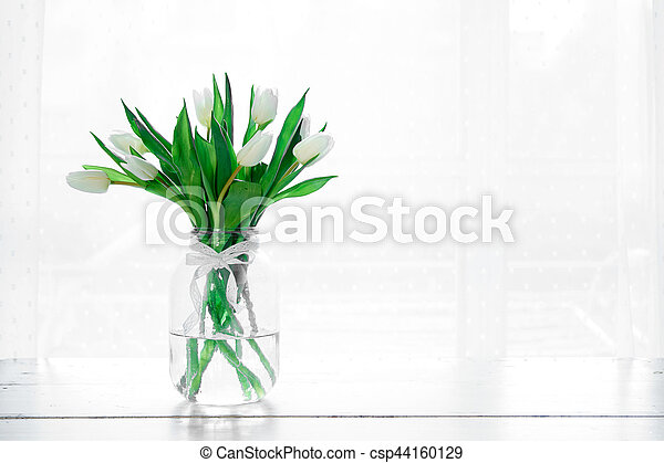 Bouquet of white tulips in a vase - csp44160129