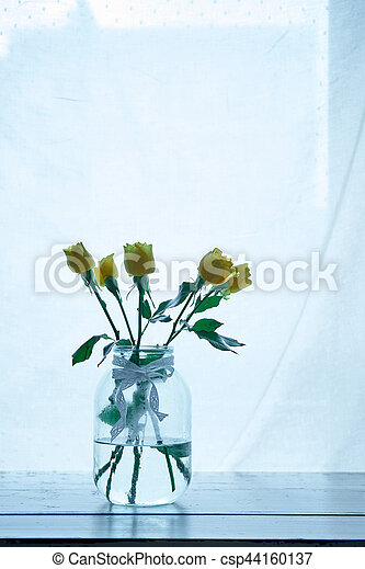 Bouquet of yellow roses in a vase - csp44160137