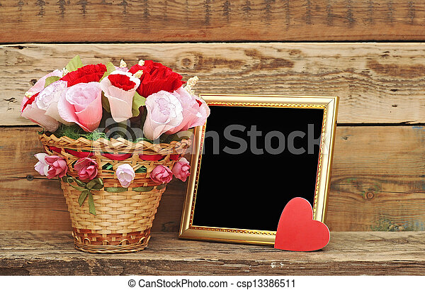 bouquet paper flower in a basket with blank photoframe - csp13386511