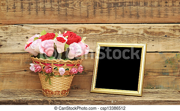 bouquet paper flower in a basket with blank photoframe - csp13386512