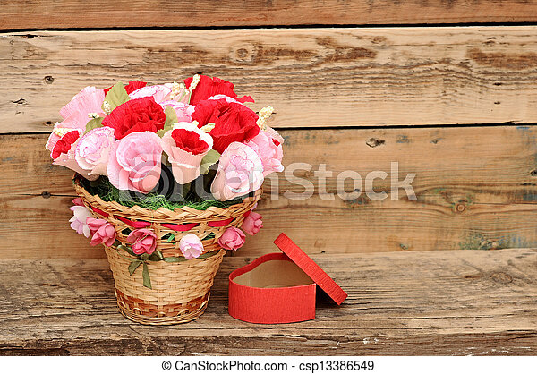 bouquet paper flower in a basket with gift box - csp13386549