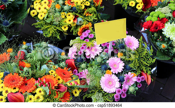 bouquets of flowers for sale by the florist to the market - csp51893464