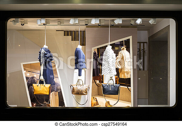 dc96ac9eaeb27 Boutique fashion display window in shop.