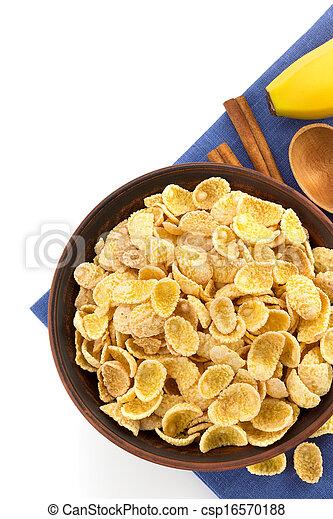 bowl of corn flakes on white - csp16570188