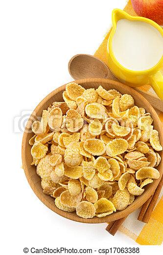 bowl of corn flakes on white - csp17063388
