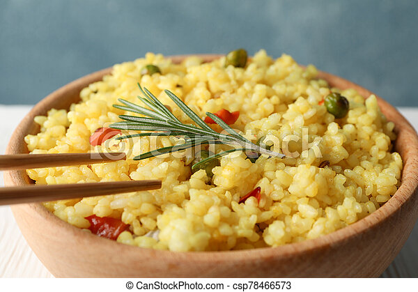 Bowl of delicious rice with vegetables, close up - csp78466573