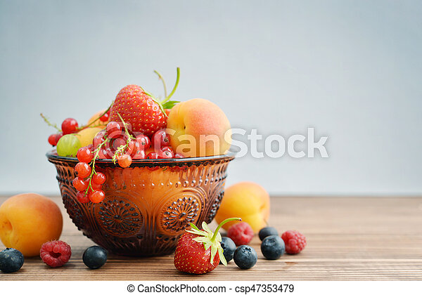 Bowl of different fresh berries - csp47353479