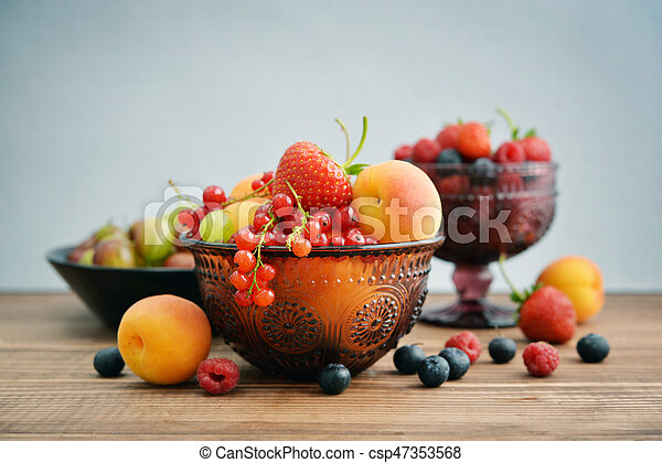 Bowl of different fresh berries - csp47353568
