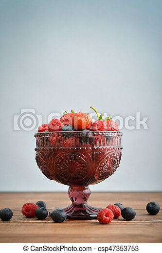 Bowl of different fresh berries - csp47353753