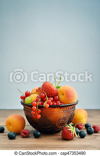Bowl of different fresh berries - csp47353490