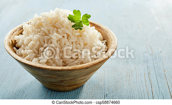 Bowl of fluffy cooked par-boiled white rice - csp58874660