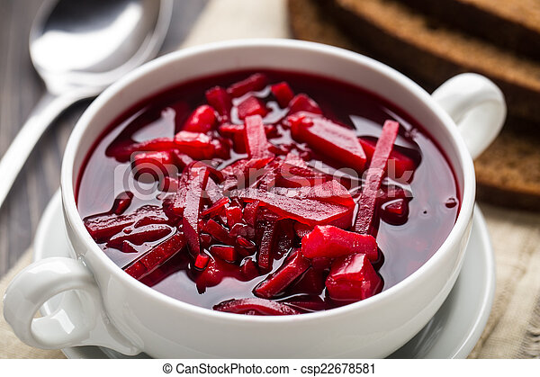 Bowl of red beetroot soup - csp22678581