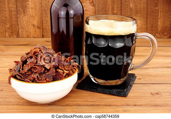 Bowl Of Shredded Biltong Meat - csp58744359