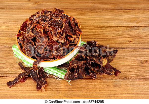 Bowl Of Shredded Biltong Meat - csp58744295