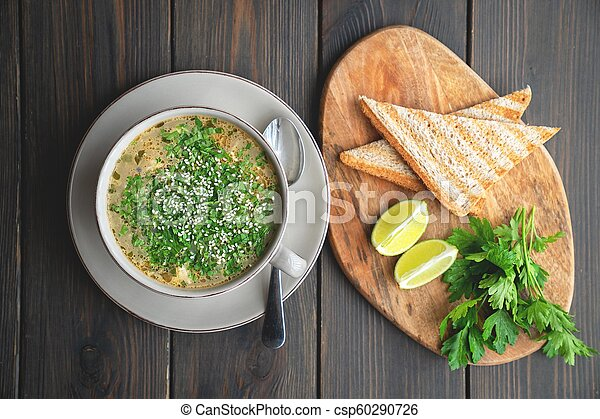 Bowl of soup with seafood with toast - csp60290726