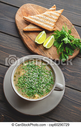Bowl of soup with seafood with toast - csp60290729