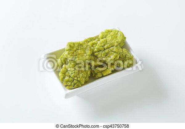 bowl of wasabi crackers - csp43750758