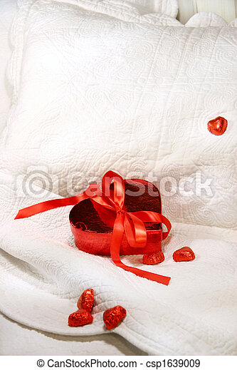 Box of chocolates with red ribbon - csp1639009