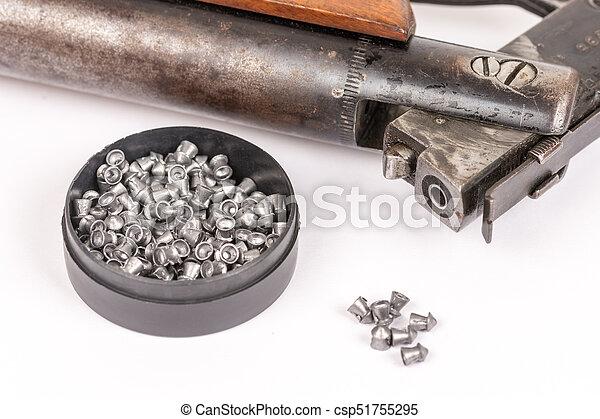 Box with metal air gun pellets and air gun with wooden kundak gunstock  above white background