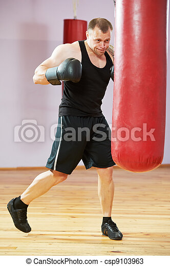 boxer man at boxing training with heavy bag - csp9103963