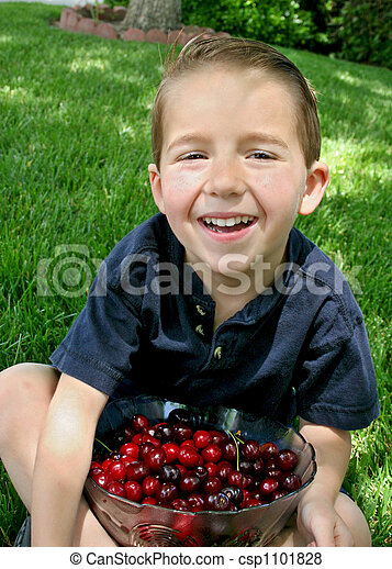 Boy and a bowl of cherries 1 - csp1101828