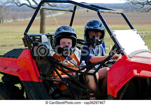 Boy and girl on dune buggy - csp36297467