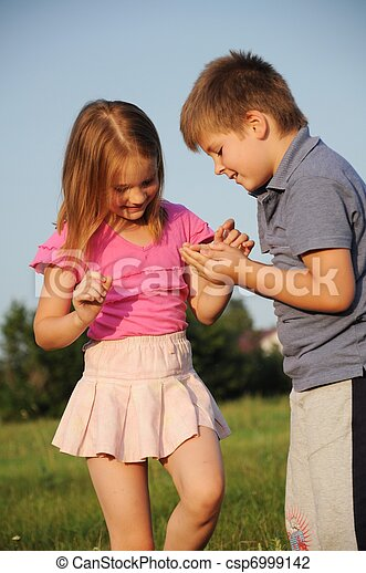 Boy and girl on grass in summer - csp6999142