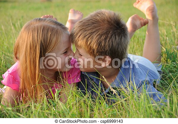Boy and girl on grass in summer - csp6999143