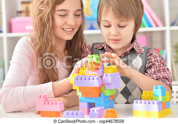 Boy and girl playing lego game - csp44678558