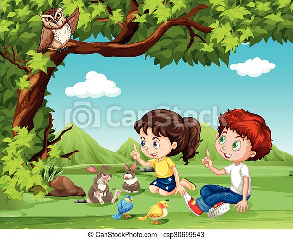 Boy and girl sitting under the tree - csp30699543