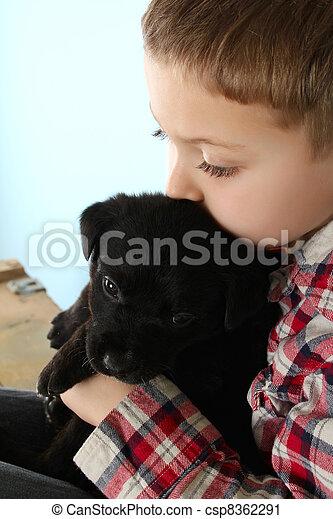 Boy and puppy - csp8362291
