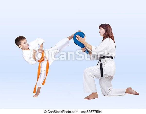 Boy beats a kick on the Double Kick Pad - csp63577594