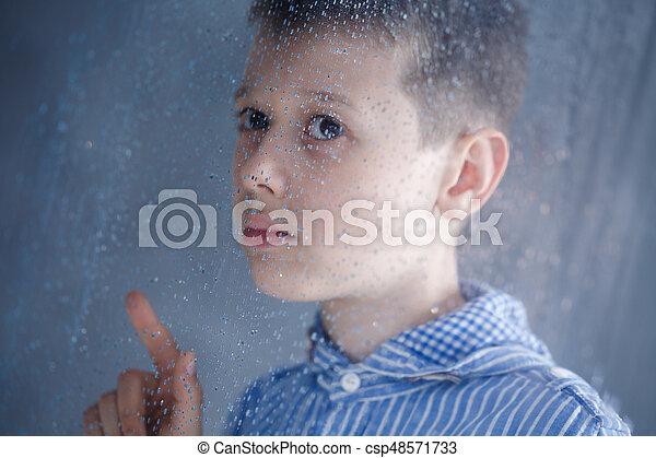 Boy behind the window - csp48571733