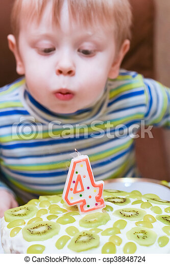 boy blows out the candles - csp38848724