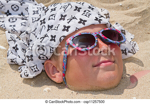 Boy buried in sand - csp11257500